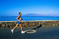J. Berger on the last leg of the Maui Marathon on Front Street, Lahaina, with the island of Lanai in the background.