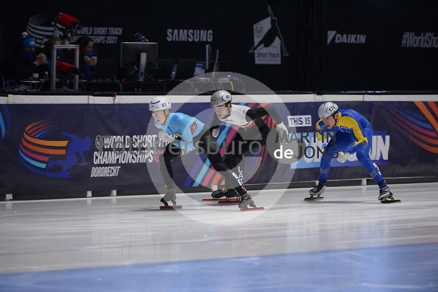 SPEEDSKATING: DORDRECHT: 06-03-2021, ISU World Short Track Speedskating Championships, RF 500m Men, Rino Vanhooren (BEL), Roberts Kruzbergs (LAT), Tarik Omeragic (BIH), ©photo Martin de Jong