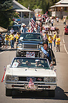 Independence Day celebration Main Street, Mokelumne Hill, California..Mr. Calaveras, Tony Boitano, as Elvis in a white Dodge convertible.