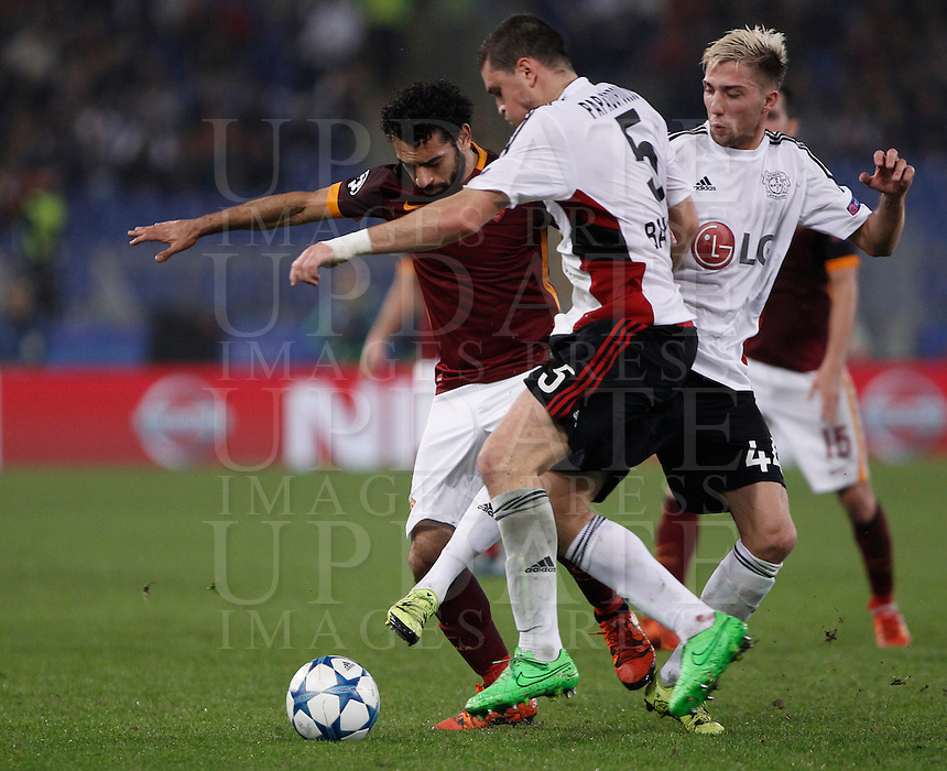 Calcio, Champions League, Gruppo E: Roma vs Bayer Leverkusen. Roma, stadio Olimpico, 4 novembre 2015.<br /> Roma's Mohamed Salah, left, is challenged by Bayer Leverkusen's Kyriakos Papadopoulos, center, and Kevin Kampl, during a Champions League, Group E football match between Roma and Bayer Leverkusen, at Rome's Olympic stadium, 4 November 2015.<br /> UPDATE IMAGES PRESS/Isabella Bonotto