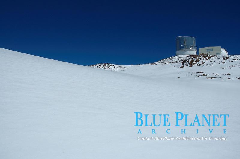 Large ice coated snow field Person walking near the Subaru Observatory Mauna Kea The Big Island of Hawaii
