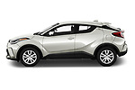 Car Driver side profile view of a 2021 Toyota C-HR LE 5 Door SUV Side View