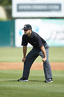 Umpire Thomas Fornarola handles the calls on the bases during the South Atlantic League game between the Lexington Legends and the Kannapolis Intimidators at Kannapolis Intimidators Stadium on May 15, 2019 in Kannapolis, North Carolina. The Legends defeated the Intimidators 4-2. (Brian Westerholt/Four Seam Images)