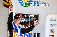 Winner Joao Barbosa, 12 Hours of Sebring, Sebring International Raceway, Sebring, FL, March 2015.  (Photo by Brian Cleary/ www.bcpix.com )