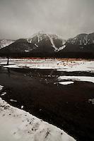Mount Yake across Taisho-ike, nearly monochrome under light snow in winter, Kamikochi, Nagano, Japan.