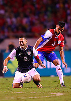 SAN JOSE, COSTA RICA - September 06, 2013: Clint Dempsey (8) of the USA MNT is hit in the back by Giancarlo Gonzalez (3) of the Costa Rica MNT during a 2014 World Cup qualifying match at the National Stadium in San Jose on September 6. USA lost 3-1.