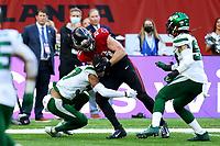 10th October 2021; Tottenham Hotspur stadium, London, England; NFL UK Series, Atlanta Falcons versus New York Jets: Atlanta Falcons Tight end Hayden Hurst (81) is tackled by New York Jets Defensive back Bryce Hall (37)