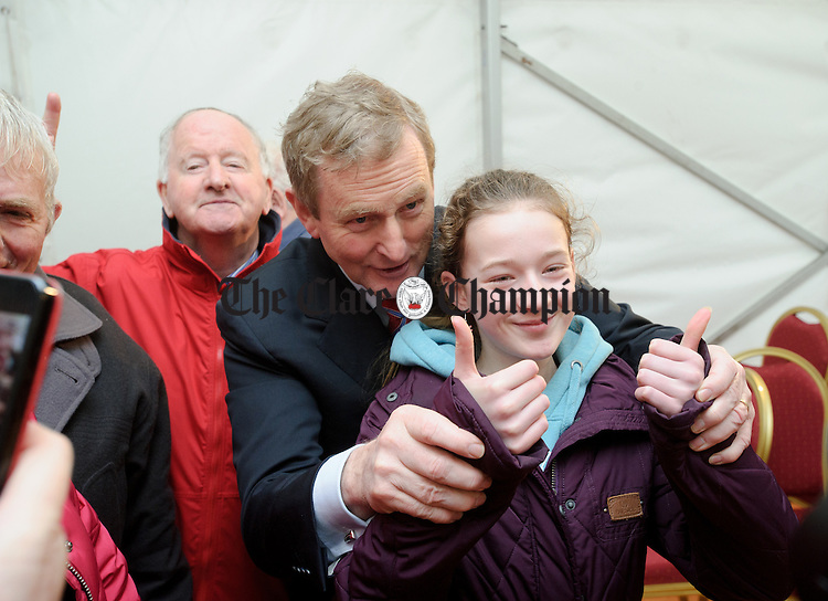 Enda Kenny, Taoiseach with  a young supporter during his visit  to Loop Head to launch the Fine Gael tourism initiative. Photograph by John Kelly.