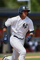 New York Yankees catcher Hemmanual Rosario (15) runs to first base during an Instructional League game against the Baltimore Orioles September 23, 2017 at the Yankees Minor League Complex in Tampa, Florida.  (Mike Janes/Four Seam Images)