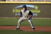 Matt Schmidt (7) of the Columbia Fireflies takes his lead off of first base against the Kannapolis Cannon Ballersat Atrium Health Ballpark on May 20, 2021 in Kannapolis, North Carolina. (Brian Westerholt/Four Seam Images)