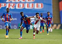 12th September 2020; Selhurst Park, London, England; English Premier League Football, Crystal Palace versus Southampton; Kyle Walker-Peters of Southampton and Wilfried Zaha of Crystal Palace chasing for the ball