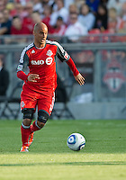 Toronto FC defender Mikael Yourassowsky #19 in action during an MLS game between the Seattle Sounders FC and the Toronto FC at BMO Field in Toronto on June 18, 2011..The Seattle Sounders FC won 1-0.