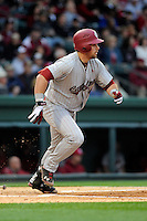 First baseman Brison Celek (24) of the South Carolina Gamecocks runs toward first base in a game against the Furman Paladins on Wednesday, April 3, 2013, at Fluor Field at the West End in Greenville, South Carolina. (Tom Priddy/Four Seam Images)