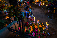 A Mexican woman sits at the flower-decorated gravesite to honor her deceased relatives during the Day of the Dead festivities in Oaxaca, Mexico, 1 November 2019. Day of the Dead (Día de Muertos), a religious holiday combining the death veneration rituals of Pre-Hispanic cultures with the Catholic practice, is widely celebrated throughout all of Mexico. Based on the belief that the souls of the departed may come back to this world on that day, people gather together while either praying or joyfully eating, drinking, and playing music, to remember friends or family members who have died and to support their souls on the spiritual journey.