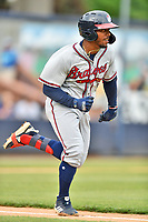 Rome Braves Justin Dean (5) runs to first base during a game against the Asheville Tourists at McCormick Field on July 18, 2019 in Asheville, North Carolina. The Tourists defeated the Braves 4-3. (Tony Farlow/Four Seam Images)