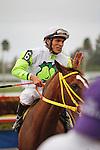 Jockey Jose Lezcano is all smiles after bringing home long shot Yara at 60-1, in the Davona Dale Stakes(G2) at Gulfstream Park. Hallandale Beach, Florida. 02-25-2012