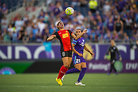 Orlando, Florida - Sunday, May 14, 2016: Western New York Flash forward Lynn Williams (9) settles the ball off her chest while defended by Orlando Pride defender Monica Hickman Alves (21) during a National Women's Soccer League match between Orlando Pride and New York Flash at Camping World Stadium.