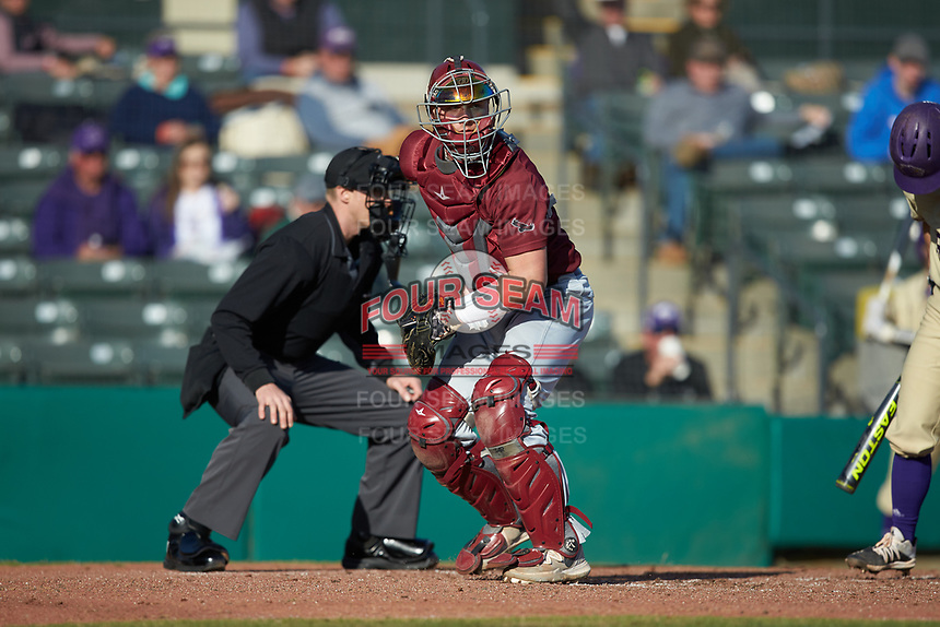 Saint Joseph's Hawks catcher Andrew Cossetti (33) checks the runner at first base during the game against the Western Carolina Catamounts at TicketReturn.com Field at Pelicans Ballpark on February 23, 2020 in Myrtle Beach, South Carolina. The Hawks defeated the Catamounts 9-2. (Brian Westerholt/Four Seam Images)