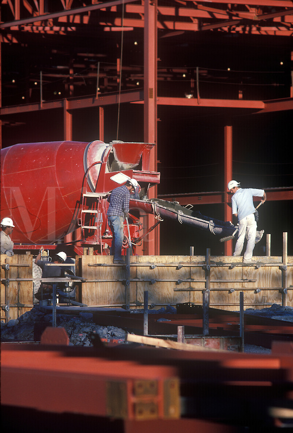 General Motors Saturn Plant under construction. Workers lay cement.