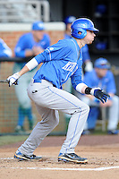 Second Baseman J.T. Riddle #10 swings at a pitch during a  game against the Tennessee Volunteers at Lindsey Nelson Stadium on March 24, 2012 in Knoxville, Tennessee. The game was suspended in the bottom of the 5th with the Wildcats leading 5-0. Tony Farlow/Four Seam Images.