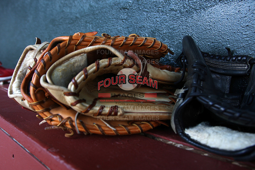 Memphis Redbirds gloves sit on the bench before a game versus the Round Rock Express at Autozone Park on April 29, 2011 in Memphis, Tennessee.  Round Rock defeated Memphis by the score of 5-4 in 13 innings.  Photo By Mike Janes/Four Seam Images
