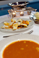 Bouillabaisse served at restaurant 'Le Calypso', Marseille, France, 25 August 2012. Bouillabaisse is a traditional Provençal fish stew originating from Marseille. Traditionally, the broth is served separately from the fish and vegetables, a portion of broth served in a bowl and the remaining broth kept hot with candles at the table.