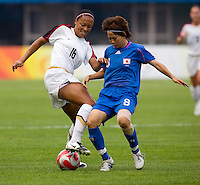 USWNT midfielder (16) Angela Hucles fights for the ball with Japanese midfielder (8) Aya Miyama while playing at Qinhuangdao Stadium. The US defeated Japan, 1-0, during first round play at the 2008 Beijing Olympics in Qinhuangdao, China.