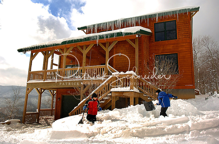 Kids dig out from a heavy snowstorm in Avery County in the North Carolina Blue Ridge Mountains.