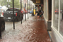 Heavy rains flooded streets in the historic French Quarter after city pumps were overwhelmed, sending residents and tourists scurrying for dry land, New Orleans, Sat., Aug. 5, 2017. (Photo by Cheryl Gerber)
