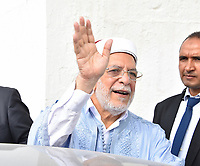 TUNIS, TUNISIA - SEPTEMBER 15: Presidential candidate Abdelfattah Mourou of Ennahdha party shows his inked finger after casting his vote at a polling station in the first round of presidential elections in Tunis, Tunisia on September 15, 2019