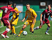 18 September 2011: University of Vermont Catamount Midfielder Brad Cole, a Sophomore from South Burlington, VT, in action against the Harvard University Crimson at Centennial Field in Burlington, Vermont. The Catamounts shut out the visiting Crimson 1-0, earning their 3rd straight victory of the 2011 season. Mandatory Credit: Ed Wolfstein Photo