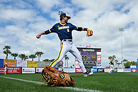 Wilson glove sits in the outfield grass as Michigan Wolverines Jonathan Engelmann (2) warms up before the second game of a doubleheader against the Canisius College Golden Griffins on February 20, 2016 at Tradition Field in St. Lucie, Florida.  Michigan defeated Canisius 3-0.  (Mike Janes/Four Seam Images)