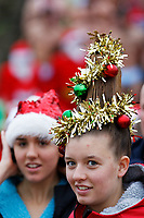 Pictured: A young woman with a Christmas Tree hairdo. Tuesday 25 December 2018<br /> Re: Hundreds of people take part in this year's Porthcawl Christmas Swim in south Wales, UK.