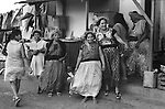 Indigenous Mexican women in traditional dresses Zapotec Tehuantepec Hand Embroidered Huipil from Oaxaca celebrating at village festival in 1970s Tehuantepec Oaxaca. Mexico