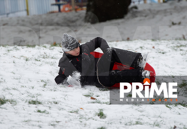 A young boy comes off his sledge in the park following Heavy Snowfall at Sidcup, Kent, England on the 8 February 2021. Photo by Alan Stanford.
