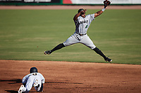 Braulio Vasquez (43) of the Augusta GreenJackets leaps for a high throw as Garrett Hiott (8) of the Charleston RiverDogs slides head first into second base at Joseph P. Riley, Jr. Park on June 27, 2021 in Charleston, South Carolina. (Brian Westerholt/Four Seam Images)