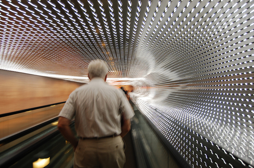 Underground is the people mover at the Museum of Modern Art in Washington, D.C. The ceiling is filled with tiny lights all moving at different times to create a wonderful effect.
