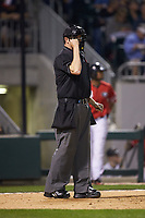 Home plate umpire Drew Maher works the NCAA baseball game between the Georgia Bulldogs and the Charlotte 49ers at BB&T Ballpark on March 8, 2016 in Charlotte, North Carolina. The 49ers defeated the Bulldogs 15-4. (Brian Westerholt/Four Seam Images)