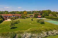 BNPS.co.uk (01202) 558833. <br /> Pic: Savills/BNPS<br /> <br /> Pictured: Gardens and tennis court.  <br /> <br /> A wheely rare opportunity...<br /> <br /> A grand country manor with a 300-year-old donkey wheel is on the market for £4.95m.<br /> <br /> The donkey wheel at Annables Manor, one of only two still in existence in England, was built in the 17th century and used to draw water from the 145ft well.<br /> <br /> The Grade II listed manor house near Harpenden, Herts, is one of the finest country houses in the area and as well as its unusual historic feature it has a heated swimming pool and tennis court in its 5.34 acres of land.<br /> <br /> The seven-bedroom home has lots of impressive features including oak beams, open fireplaces and solid oak floors.