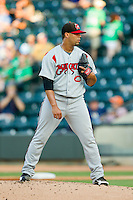 Carolina Mudcats starting pitcher Joseph Colon (29) looks to his catcher for the sign against the Winston-Salem Dash at BB&T Ballpark on July 25, 2013 in Winston-Salem, North Carolina.  The Mudcats defeated the Dash 5-4.  (Brian Westerholt/Four Seam Images)