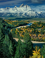 749450006a fall color graces the aspens while clearing storm clouds partially hide the teton range at the snake river overlook grand tetons national park wyoming