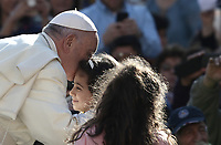 Papa Francesco bacia una bambina al suo arrivo all'udienza generale del mercoledi' in Piazza San Pietro, Citta' del Vaticano, 10 ottobre 2018.<br /> Pope Francis kisses a child as he arrives to lead his weekly general audience in St. Peter's Square at the Vatican, on October 10, 2018.<br /> <br /> STRICTLY ONLY FOR EDITORIAL USE