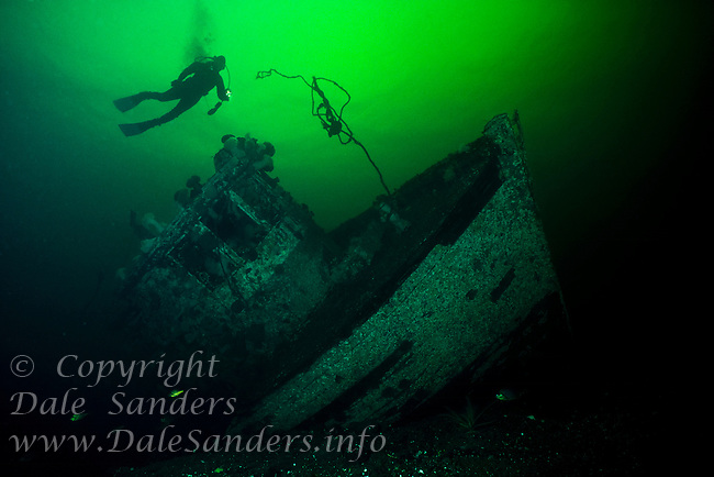Scuba Diver explores the wreck of a sunken fishing vessel in Jervis Inlet, British Columbia, Canada.
