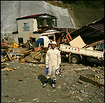 """Yuki Hashimoto, 22, a volunteer worker from Tokyo, helping to remove debris in the tsunami-affected area in Kamaishi, Iwate, in one month after the earthquake and tsunami. """"I wanted to do something for the victims, but I did not know what I can do,"""" Hashimoto said. When he was feeling almost guilty that he could not do anything for them, he received an email that is looking for a volunteer worker to clean up the debris. He applied right away. """"I came here to help people because I felt sorry,"""" he said. After working for them, he noticed that it was a kind of self-satisfaction and arrogant of him. """"Now, I feel more humble and grateful that they let me help them,"""" he said.<br /> On March 11, 2011, the earthquake of magnitude 9.0, the biggest earthquake in the history of Japan and the fourth biggest earthquake in the world after year 1900, shocked the Tohoku area of Japan. In about 30 minutes, devastating tsunami reached, affecting the coastline with a length of 500 km (310 miles). The tsunami wave height of 39 meters (128 feet) was recorded in a port town in Tohoku. The tsunami swallowed villages along the coast and washed away all houses. The earthquake and tsunami killed more than 15,800 people, and still more than 3,500 people are missing."""