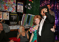 Randy Jones (original cowboy Village People) sings YMCA as One Life To Live's Ilene Kristen and Tina McKissick watch on April 28, 2010 at Will Clark's P*rno Bingo at Pieces, New York City, New York to benefit the American Foundation for Suicide Prevention - an event presented by We Love Soaps (Damon Jacobs and Roger Newcomb). (Photos by Sue Coflin/Max Photos)