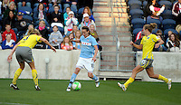 Chicago forward Kosovare Asllani (10) looks for space between Philadelphia defenders Allison Falk (3) and Nikki Krzysik (15).  The Philadelphia Independence defeated the Chicago Red Stars 1-0 at Toyota Park in Bridgeview, IL on May 15, 2010.