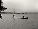 Seminole family in dugout canoe