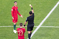 SARANSK, RUSSIA - June 25, 2018: Cristiano Ronaldo of Portugal is shown a yellow card by referee Enrique Caceres in their 2018 FIFA World Cup group stage match against Iran at Mordovia Arena.