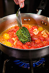 30 {month name} 2013 -- MCC food demo Tomato Basil Ragu Inspired Home Magazine. Metropolitan Community College Chef Brian O'Malley makes a dish that contains a Goat Cheese Polenta base with a fried tomato and topped with a tomato basil ragu. Picture by Daniel Johnson (Copyright 2013 Daniel Johnson)