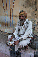 Jaipur, Rajasthan, India.  Elderly Beggar Sitting by the Side of the Street.